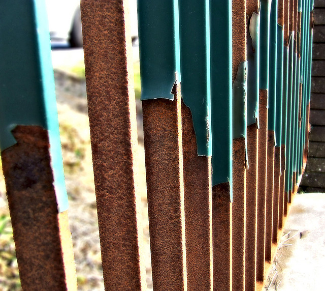 worn metal fence